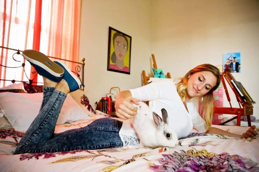 Teenage Girl With Bunny On Bed